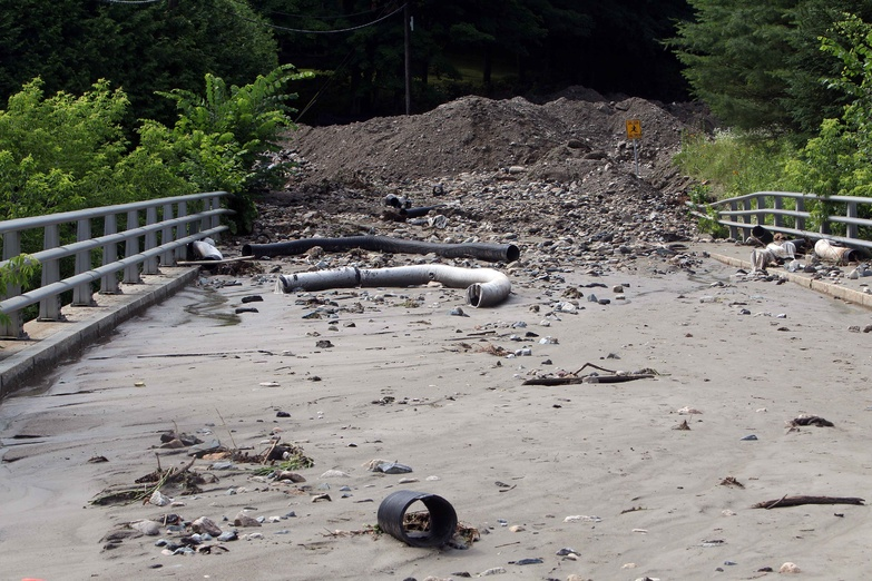 Debris from a mudslide covers a road in Lebanon, N.H., Wednesday after heavy rains caused flash flooding in the area.