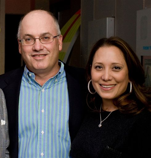 In this Dec. 10, 2009, photo released by Peppe Communications, billionaire hedge fund manager Steven Cohen and his wife, Alexandra, attend a benefit in New York.