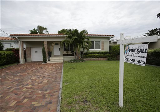 A single-family home is shown for sale in Surfside, Fla., recently. Higher home prices make homeowners feel wealthier, encouraging consumers to spend more.