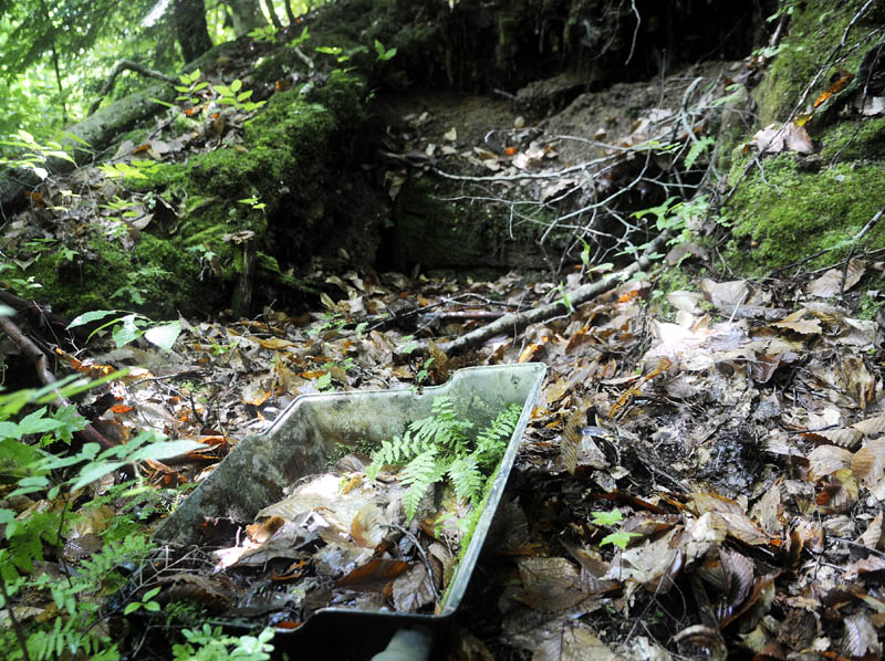 The overturned lid of a gas grill is covered in leaves in the collapse shelter in Rome that Garrett Hollands said was discovered in the late 1980s. Wednesday July 3