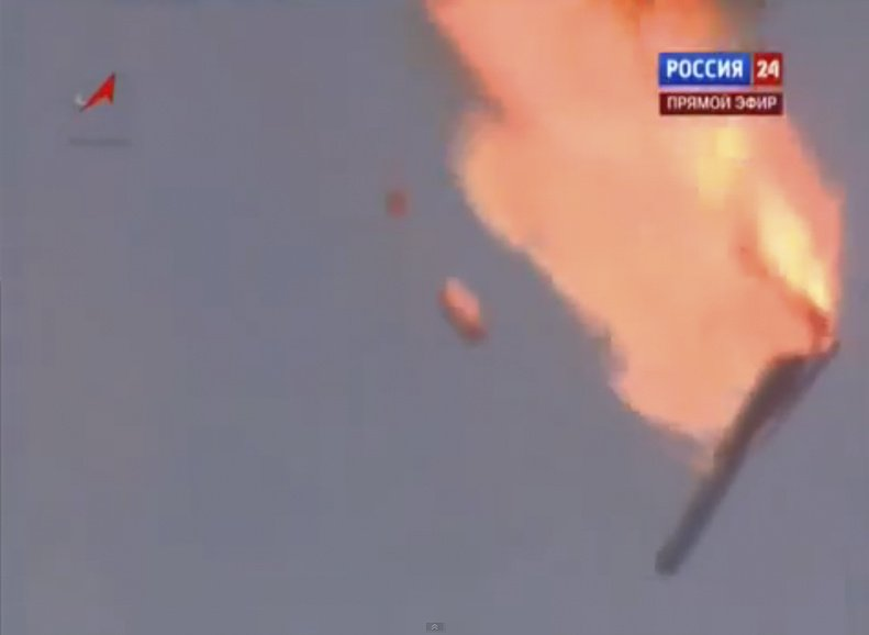 In this frame grab made from TV footage, a Russian booster rocket carrying three satellites crashes at a Russia-leased cosmodrome in Kazakhstan on Tuesday shortly after the launch.