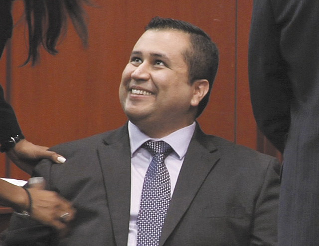 In this image from video, George Zimmerman smiles after a not guilty verdict was handed down in his trial at the Seminole County Courthouse on Saturday in Sanford, Fla. Zimmerman was cleared of all charges Saturday in the shooting of Trayvon Martin, the unarmed black teenager whose killing unleashed furious debate across the U.S. over racial profiling, self-defense and equal justice.