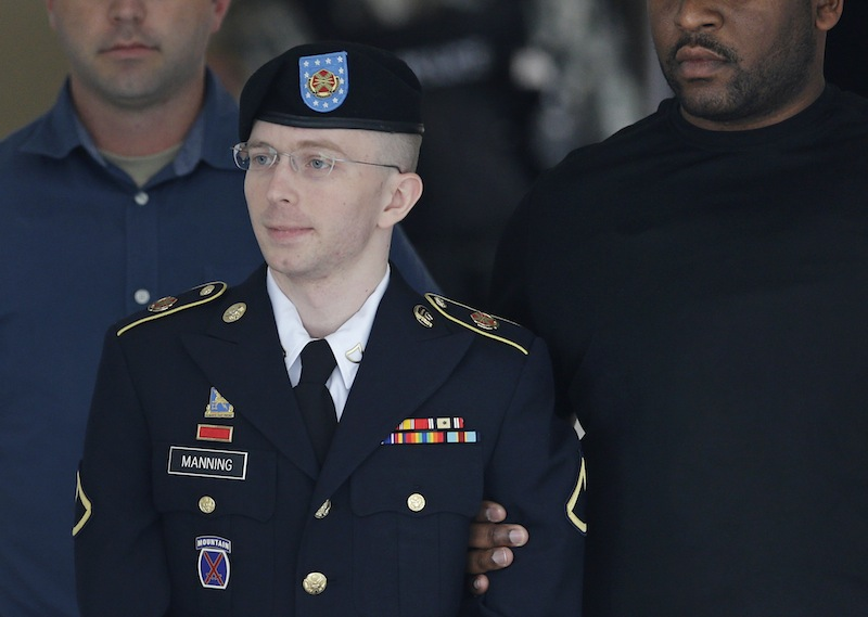 Army Pfc. Bradley Manning is escorted out of a courthouse in Fort Meade, Md., Tuesday, July 30, 2013, after receiving a verdict in his court martial. Manning was acquitted of aiding the enemy — the most serious charge he faced — but was convicted of espionage, theft and other charges, more than three years after he spilled secrets to WikiLeaks. (AP Photo/Patrick Semansky)