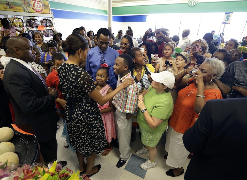 First lady Michelle Obama greets customers at Sterling Farms Grocery Store in Marrero, La., Tuesday, July 23, 2013. The store was opened last year by actor Wendell Pierce as part of the