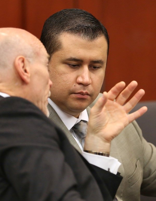 George Zimmerman listens to defense counsel Don West during his trial in Seminole Circuit Court, in Sanford, Fla., Tuesday, July 9, 2013. Zimmerman is charged with second-degree murder in the fatal shooting of Trayvon Martin, an unarmed teen, in 2012. (AP Photo/Orlando Sentinel, Joe Burbank, Pool)