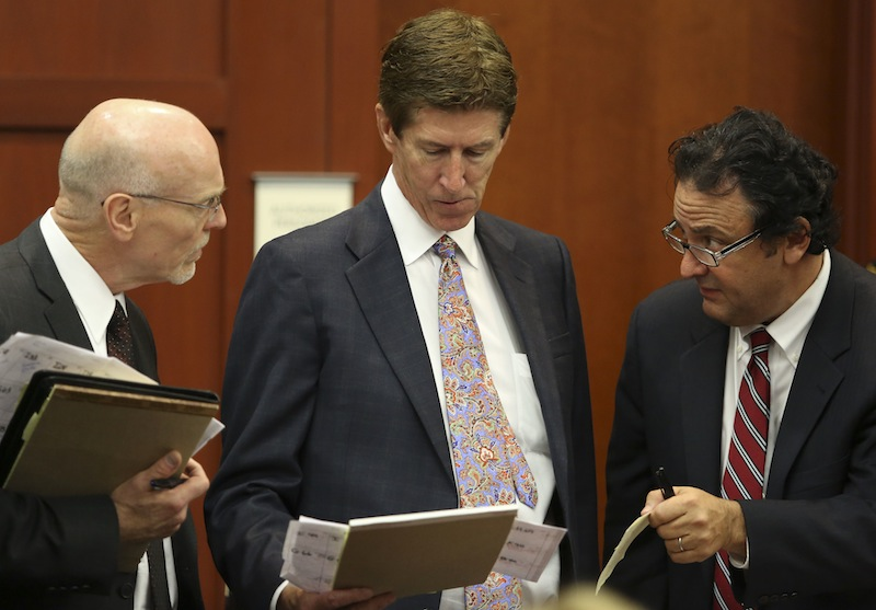 In this June 20, 2013 file photo, co-defense attorney Don West, left, defense attorney Mark O'Mara, center, and jury consultant Robert Hirschhorn go over their juror list during the final stages of jury selection in the George Zimmerman trial in Sanford, Fla. (AP Photo/Orlando Sentinel, Gary Green, Pool)