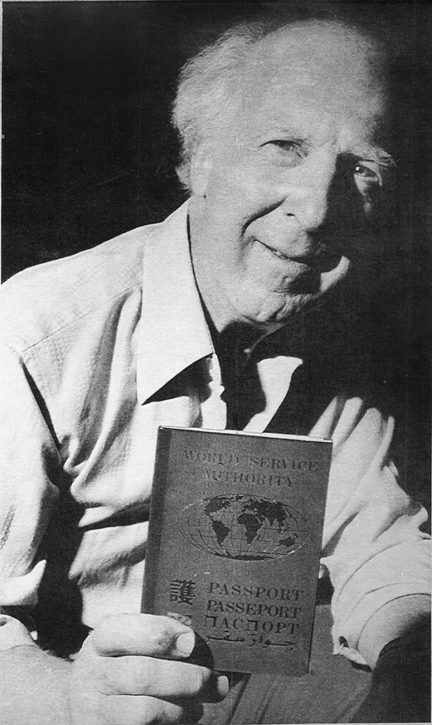 In this Sept. 13, 1988 file photo, Garry Davis, who renounced his U.S. citizenship in 1948 and for the next six decades led a movement for global citizenship, holds a passports issued by the World Service Authority, a non-profit group he founded in 1954 to help promote his goal of a world with no borders.The World Service Authority confirmed Davis died Wednesday, July 24, 2013 in Williston, Vt., at the age of 91. (AP Photo, File)