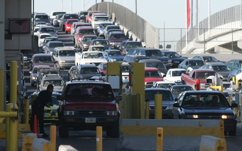 In this Monday, June 1, 2009 file photo, traffic lines up to enter the United States at the Bridge of the Americas port-of-entry in El Paso, Texas. A Vermont ski area near the Canadian border is willing to pay the U.S. Homeland Security Department to ensure there are enough customs agents at the border on weekends so that Canadian skiers don't have to wait. It's part of a pilot program taking place at certain ports of entry around the country. (AP Photo/Victor Calzada, File)