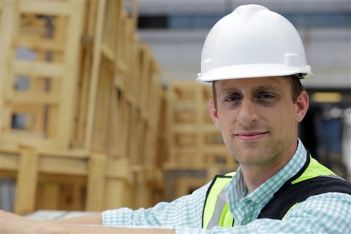 Drew Miller, shown here at a building under construction on Wednesday in Silver Spring, Md., quit a steady government job to take a chance on a company that's using
