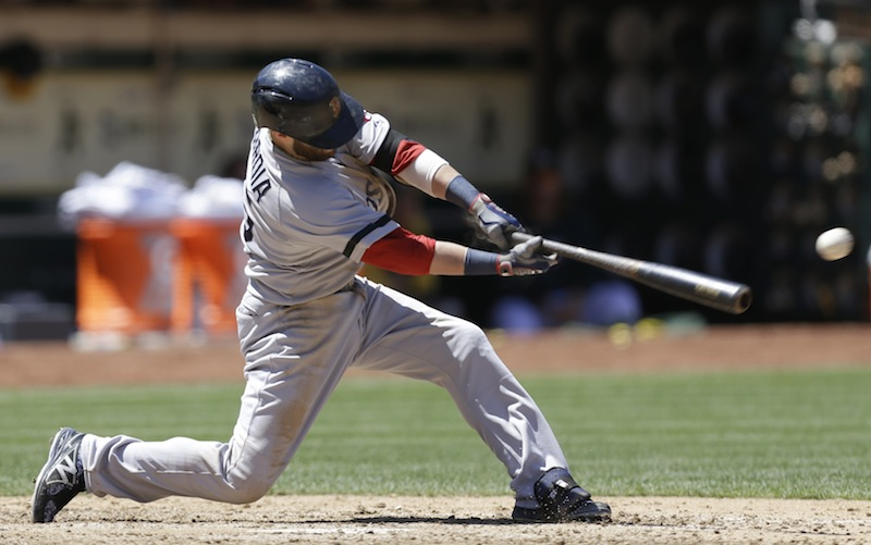 Boston Red Sox's Dustin Pedroia connects for an RBI single off Oakland Athletics' Bartolo Colon in the sixth inning of a baseball game Sunday, July 14, 2013, in Oakland, Calif. (AP Photo/Ben Margot)