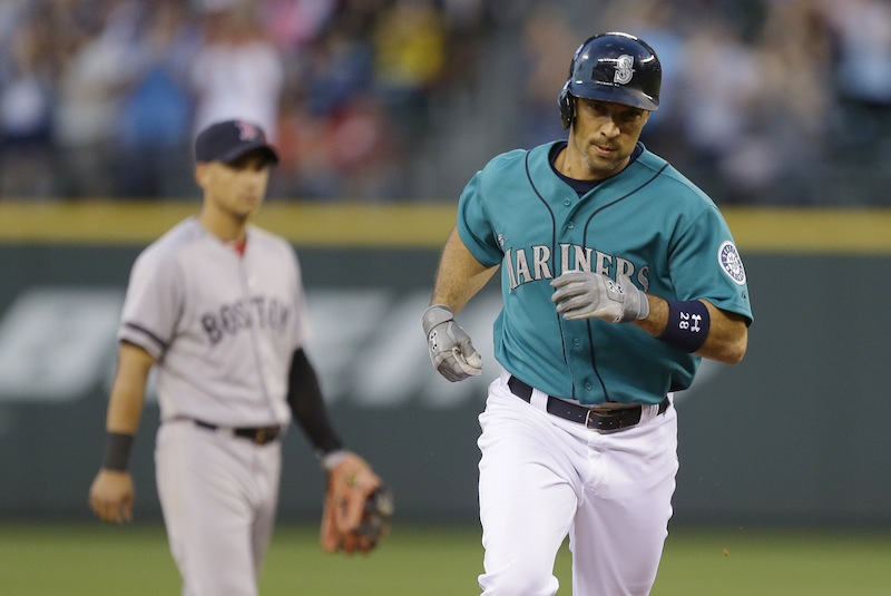 Seattle Mariners' Raul Ibanez, right, 'rounds the bases after hitting a solo home run against the Boston Red Sox in the fifth inning of a baseball game, Monday, July 8, 2013, in Seattle. (AP Photo/Ted S. Warren)