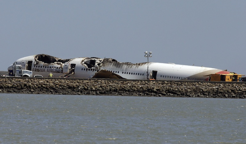 The wreckage of Asiana Flight 214, which crashed on Saturday, July 6, 2013, is seen on a tarmac at San Francisco International Airport in San Francisco, Tuesday, July 9, 2013. (AP Photo/Jeff Chiu)