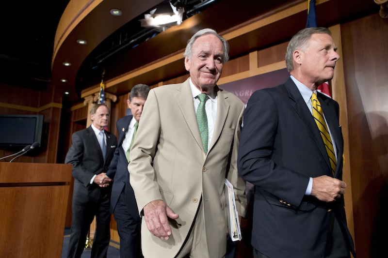 In this July 18, 2013, file photo from right, Sen.s Richard Burr, R-N.C., and Tom Harkin, D-Iowa, chair of the Senate Education Committee, leave a Capitol Hill news conference after announcing a bipartisan agreement on rates for government student loans. The House gave its stamp of approval to the Senate compromise that would link college students' interest rates to the financial markets and offer borrowers lower rates this fall. From left are Sens. Tom Carper, D-Del. and Joe Manchin, D-W.V, (AP Photo/J. Scott Applewhite, File)