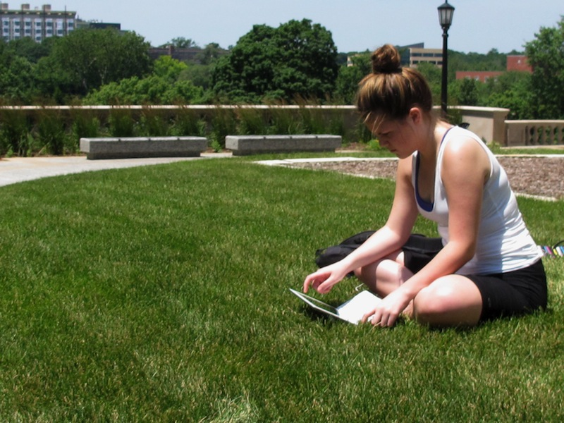 In this July 1 file photo, student Angie Platt, 20, is seen on the University of Iowa campus. Although the recession is over, costs and concerns about job loss and tuition hikes are still driving families' and students' decisions on which colleges to attend and what to major in, according to an annual survey released by loan giant Sallie Mae on Tuesday. Nationally, college spending per student was about $21,000 during 2011-12. (AP Photo/Ryan J. Foley)