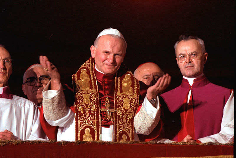 In this Oct. 22, 1978 file photo Pope John Paul II blesses the faithful in St. Peter's Square from a Vatican City balcony right after he was named Pontiff. A Vatican official says Pope John Paul II has cleared the final obstacle before being made a saint. A commission of cardinals and bishops reportedly met Tuesday, July 2, 2013 to consider the case and signed off on it, leaving only Pope Francis to approve it. A Vatican official confirmed that the decision had been taken some time back and that Tuesday's meeting was essentially a formality.