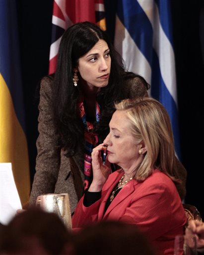 Huma Abedin, then-deputy chief of staff and aide to then-Secretary of State Hillary Rodham Clinton, right, confers with Clinton during a meeting in New York in this Sept. 20, 2011, photo.