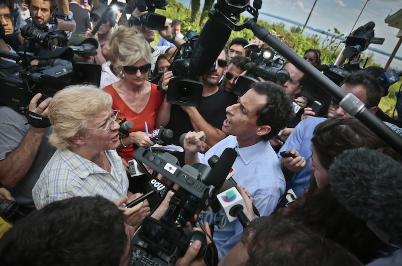 """New York City mayoral candidate Anthony Weiner, right, reacts to a question from Peg Brunda during a tour of Superstorm Sandy victims on Staten Island on Friday, July 26, 2013 in New York. Brunda confronted the candidate, telling him he didn't have the """"moral authority"""" to lead the city, as he tries to move past the sexting scandal threatening to derail his attempted political comeback. (AP Photo/Bebeto Matthews)"""