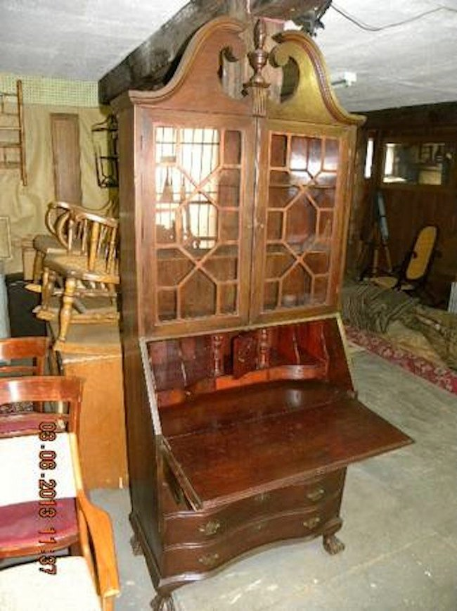 Alex MacPhail said the burglars cut the lock to his unit and stole antique furniture, memorabilia, personal photographs, jewelry and family heirlooms, including an antique, 7-foot-tall Governor Winthrop desk. Above, a replica of the stolen desk.