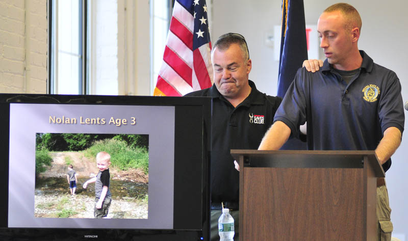 Ed Hinchey of Safariland, left, and Indiana State Police Trooper Jarrod Lents speak Wednesday at Tex Tech Industries in North Monmouth.