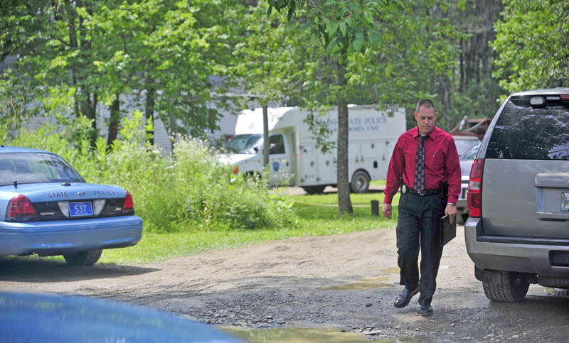 Maine State Police search the residence at 24 Main Street in Detroit on Friday where a man was found dead Thursday morning.