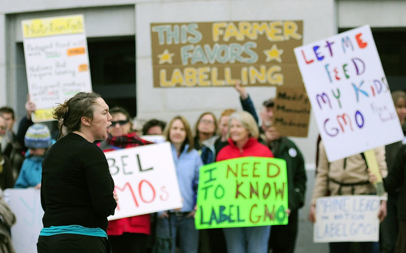 Logan Perkins, Right to Know-GMO Campaign Coordinator for Maine Organic Farmers and Gardeners Association, speaks at a rally outside the Maine State House on Tuesday April 23, 2013. Advocates of a bill that would require food producers to label products containing genetically modified ingredients believe they've won a key ally: Gov. Paul LePage.