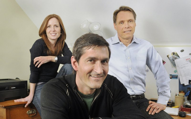 Portland residents, from left, Kate and Colin Snyder and Robert Bruce are running BoodleUP, which invites users to win prizes from advertisers.