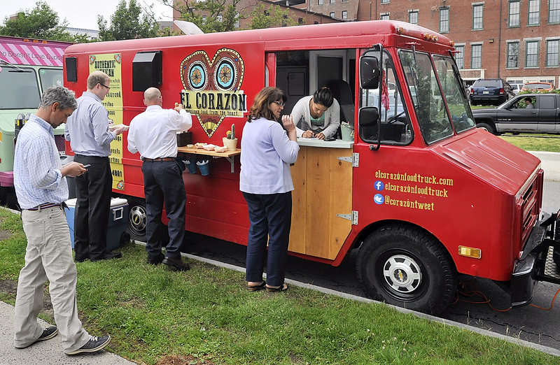 April Garcia takes orders from walk-up customers hungry for authentic Mexican food at the El Corazon food truck.