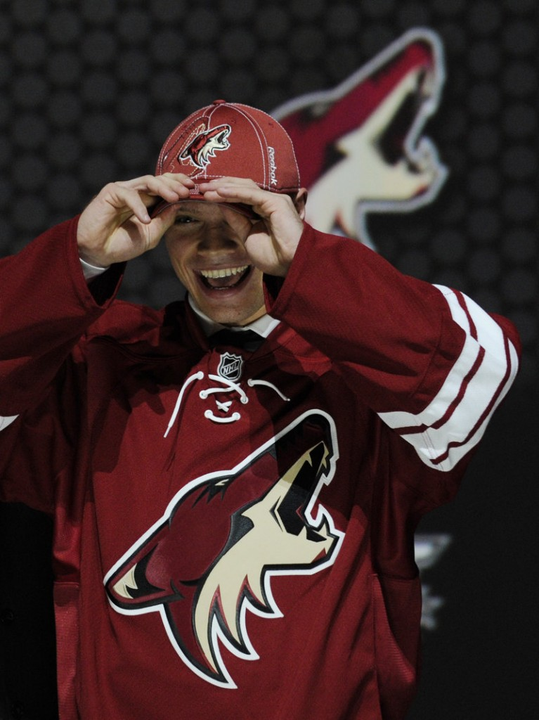 Max Domi, whose father has the third-most penalty minutes in NHL history, is all smiles after being selected in the first round by the Coyotes Sunday.