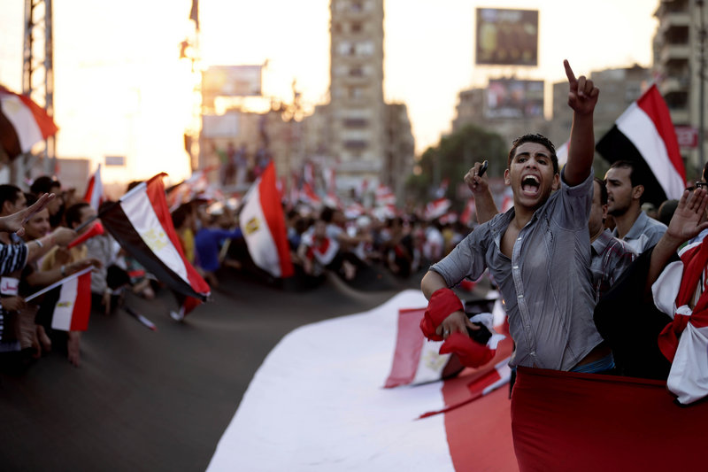 Opponents of Egypt's Islamist President Mohammed Morsi protest outside the presidential palace, in Cairo, Egypt, Monday, July 1, 2013. Egypt's military on Monday issued a 48-hour ultimatum to the Islamist president and his opponents to reach an agreement to