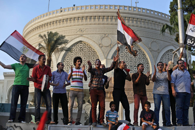 Protesters call for the ouster of President Mohammed Morsi outside the presidential palace in Cairo on Tuesday. Clashes broke out between protesters and Morsi supporters.