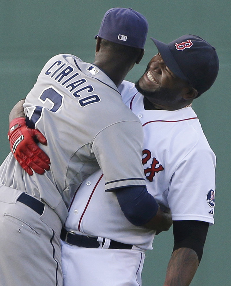 Boston's David Ortiz, right, hugs former teammate Pedro Ciriaco of the Padres before Tuesday's game.