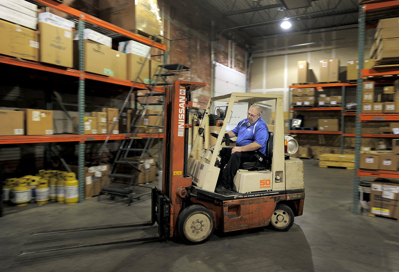 Bob Prescott drives a forklift at his new job for Distributor Corp. of New England in Westbrook last week.