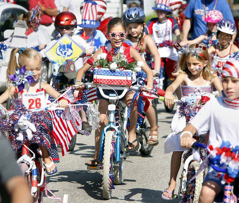 Hailey LaRosa, 8, of Newburyport, Mass., freshened her ride with a basket of red and white flowers. Her family visits friends in Ocean Park each year to take part in July Fourth festivities.