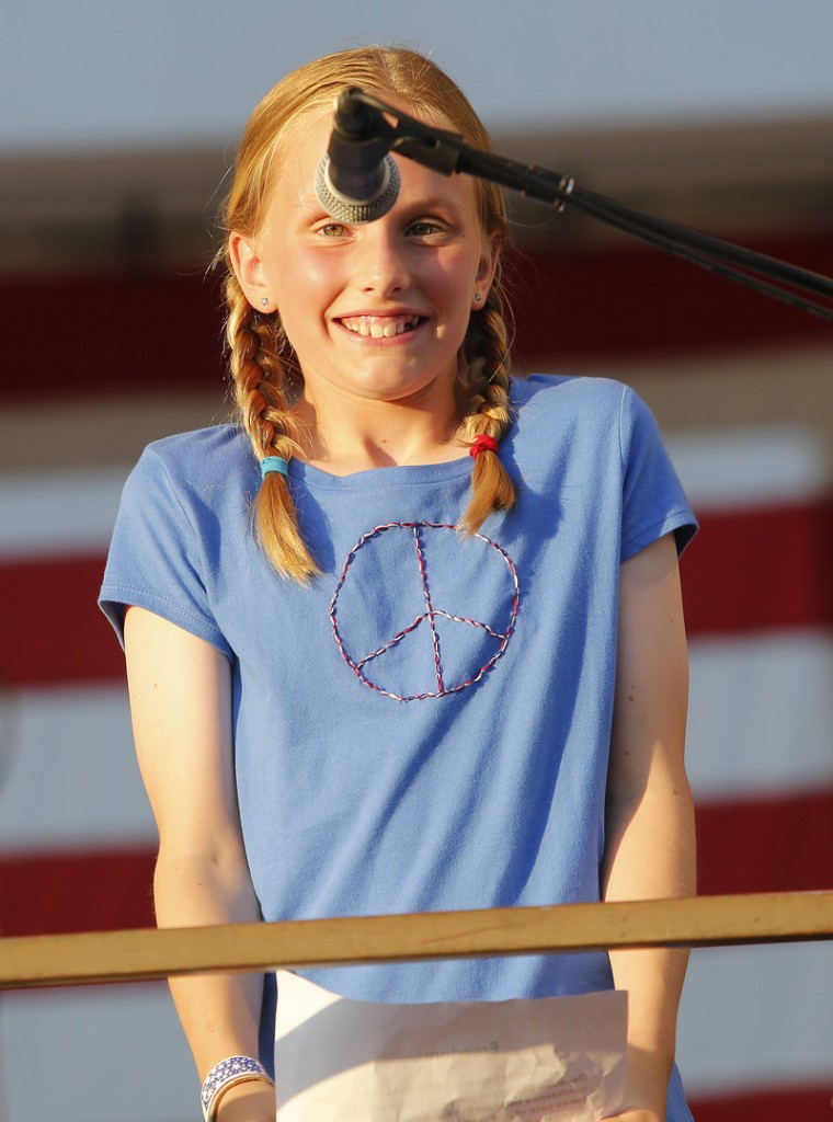 "The microphone could use some adjusting as 11-year-old Hope Carroll of Portland gets ready to read her contest-winning essay, ""What Freedom Means to Me,"" during the Stars and Stripes Spectacular Fourth of July celebration Thursday on Portland's Eastern Prom."