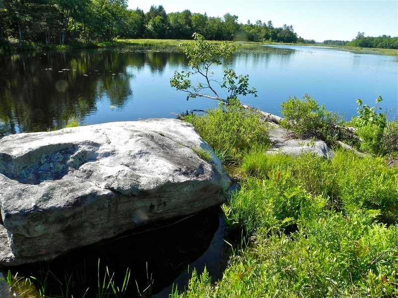 Shorefront boulders provide for convenient resting and lunch spots after a couple hours of robust paddling.