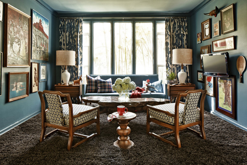 A red, white and blue palette with wood tones and muted browns creates a rich, layered look in this weekend home.