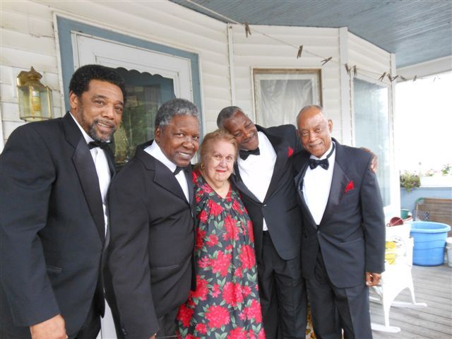 Members of the legendary R&B group the Drifters visit with longtime fan Yvonne Gretta of Sanford on the afternoon of the group's July 1 concert. Gretta, a lifelong fan, was unable to attend the concert so the group surprised her.