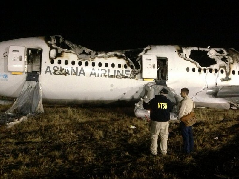 Investigators work amid the wreckage of an Asiana Airlines Boeing 777 in San Francisco as they try to determine the cause of Saturday's accident. Two people died in the crash and officials say it appears the plane was flying too slow when it struck a sea wall just in front of the runway.