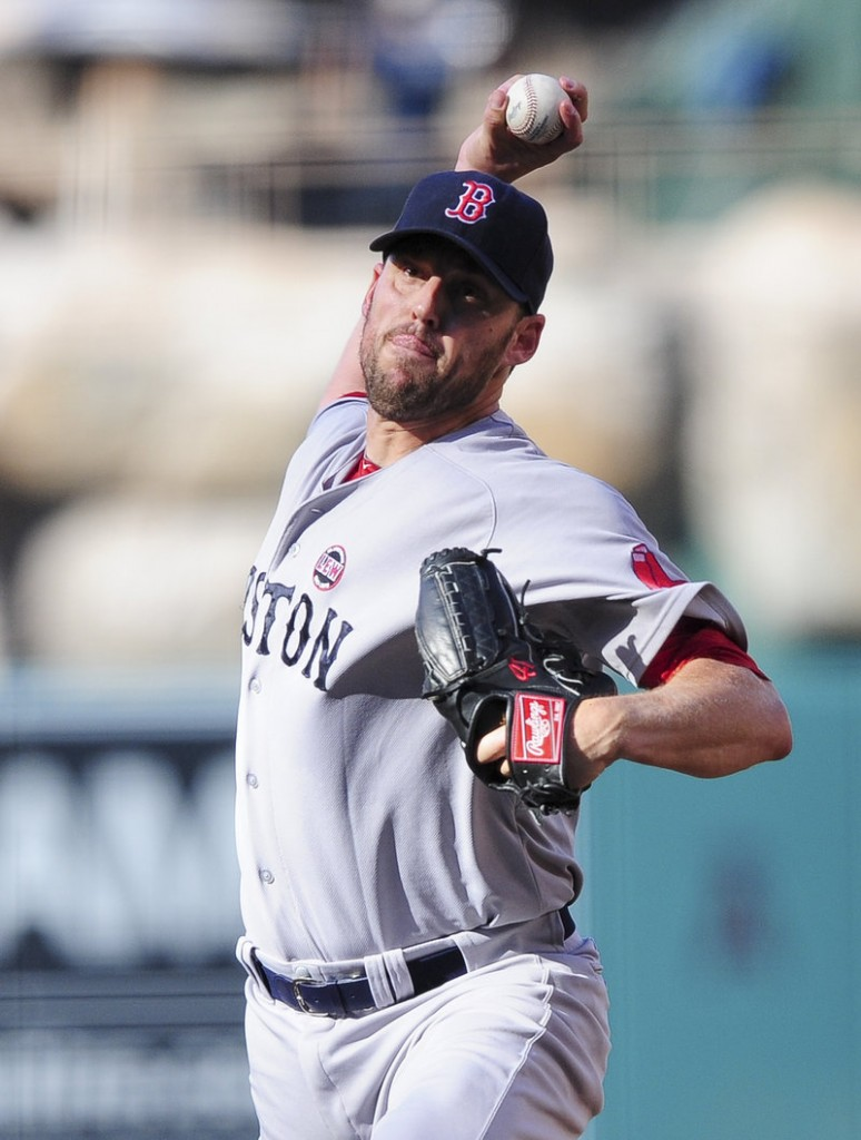 John Lackey turned in another strong start but was tagged with the loss after giving up two runs and five hits in seven innings.