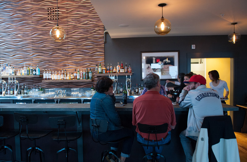 The award-winning designers of Outliers Eatery on York Street in Portland's West End transformed the former Popeye's space into a visually striking place to eat and drink.