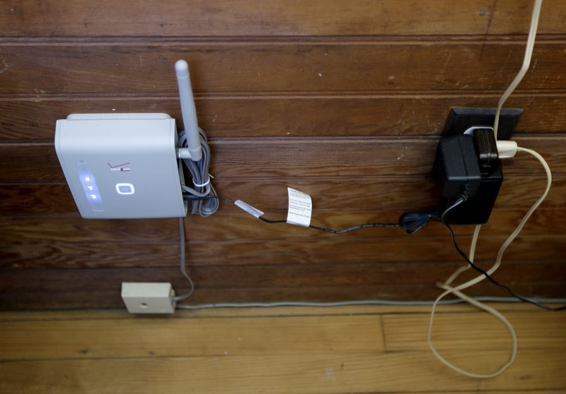 This wireless device connected to Robert Post's home wiring provides phone service, but the system does not work for checking pacemakers.