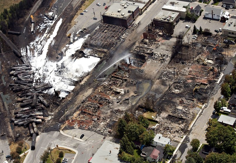 Wreckage is strewn through the downtown core in Lac-Megantic, Quebec, Monday, July 8, 2013, after a train derailed, igniting tanker cars carrying crude oil early Saturday. (AP Photo/The Canadian Press, Ryan Remiorz)