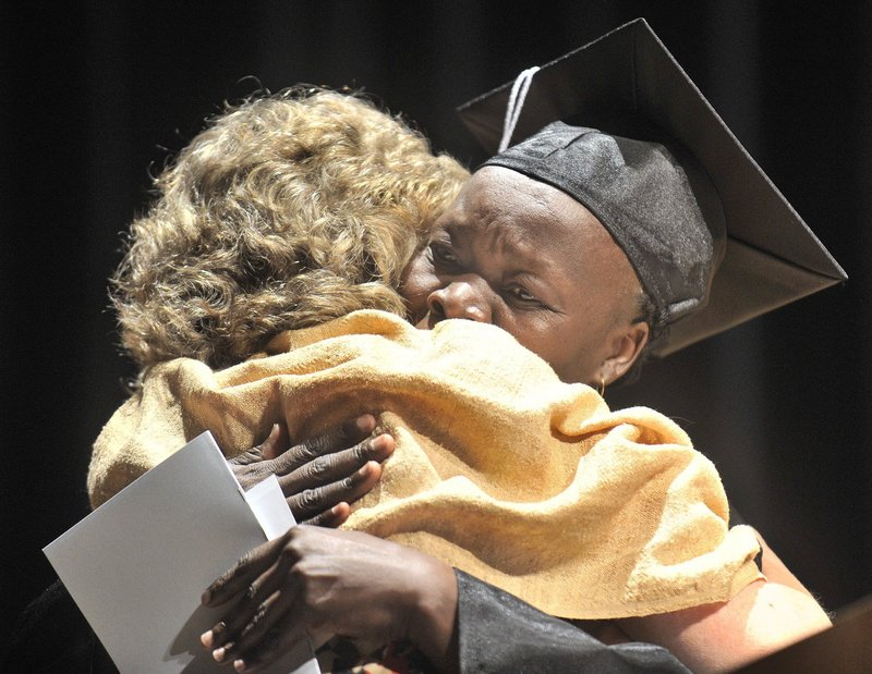 Portland Adult Education staff member Valerie deVuyst shares a hug with graduate Lia Boulis Kodi at the program's 2011 graduation ceremony. The program needs a new location that will support its growing enrollment, a reader says.
