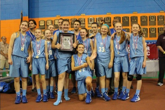 Members of the Yes! sixth-grade girls' basketball team, from left to right: Kneeling: Meghan Hoffses; Front row: Mandy Mastropasqua, Isabel Dawson, Catherine Reid, Mackenzie Holmes, Mackenzie Emery, Meg Kelly, Julia Martel and Lucy Leen; Back: Coach Eric Dawson, Claire Brady, Coach Lenny Holmes, Coach Bob Emery, Clementine Blaschke and Head Coach Dudley Davis.