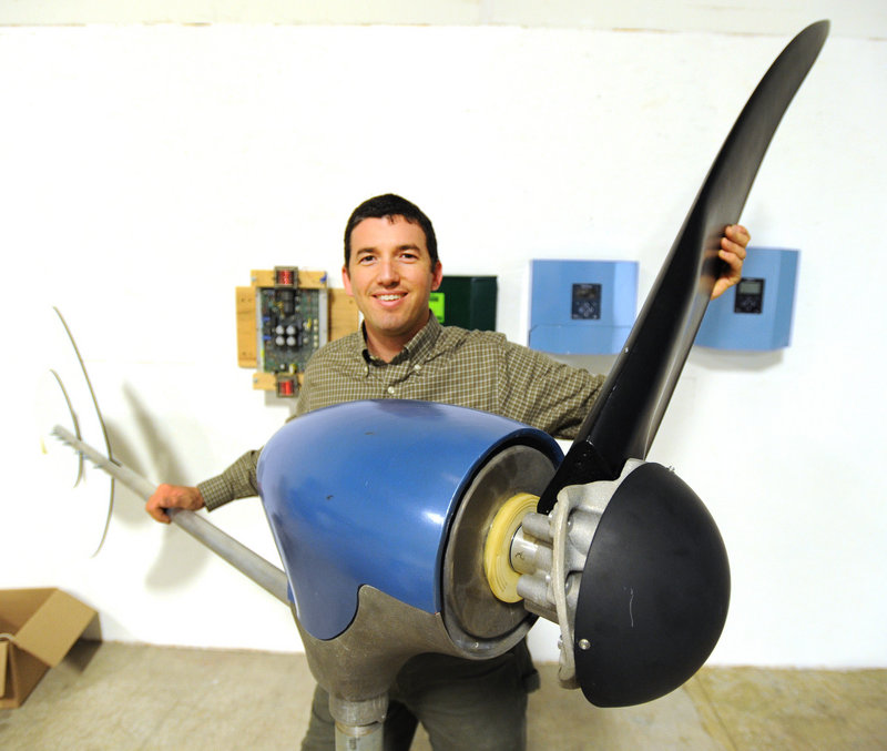 Ben Polito, president of Pika Energy in Westbrook, holds one of three blades on a wind turbine at his new facility.