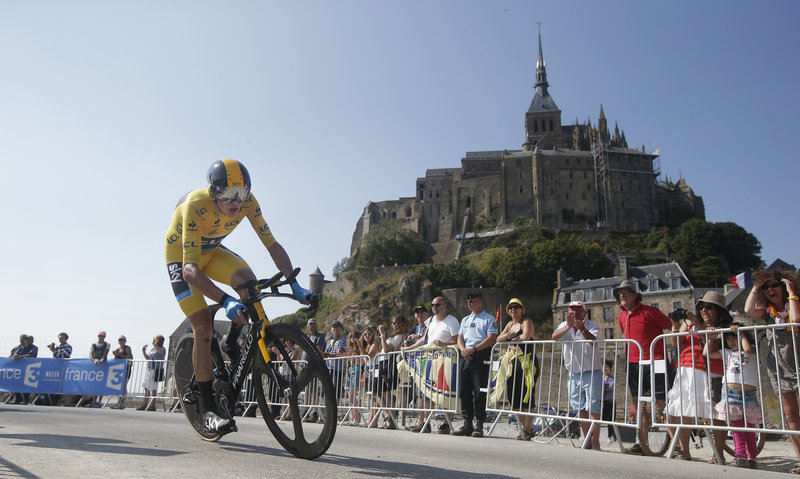Chris Froome, who has taken command of the Tour de France, passes a world heritage site, Mont-Saint-Michel, a rocky tidal island that holds a monastery, during the 11th stage of the race Wednesday.