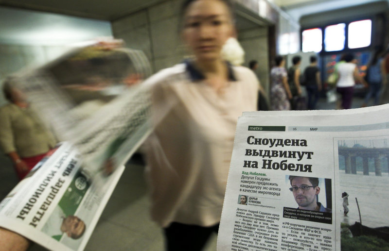 A picture of former U.S. spy agency contractor Edward Snowden is featured prominently on a newspaper at an underground walkway in central Moscow.