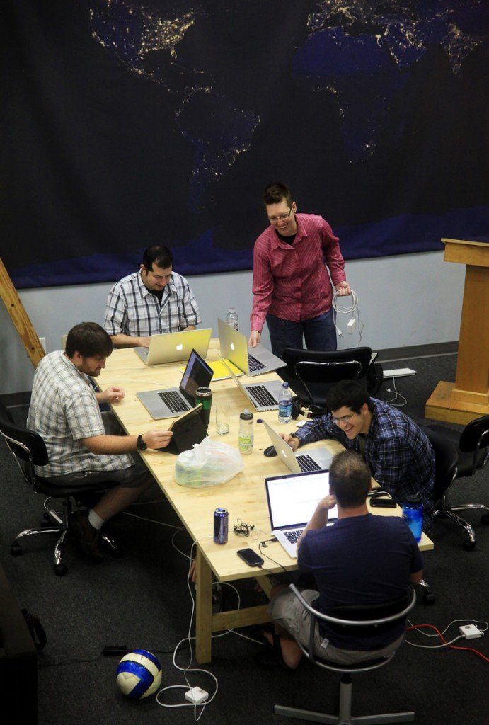 Employees of Cash Star, a Portland-based national company, brainstorm Thursday at Think Tank, a local business that rents office-style work space shared by freelancers and startups.