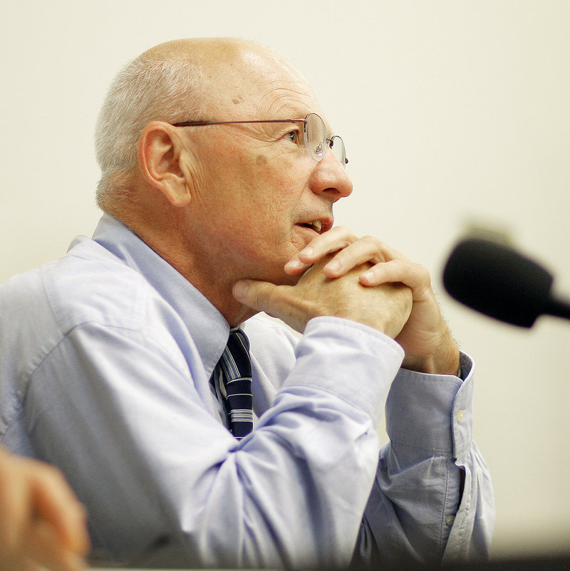 Mayor Michael Brennan contemplates an answer to a question from a resident Thursday.