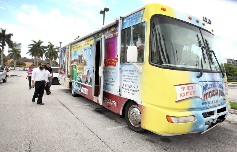 Adam Ogen is a volunteer for the mitzvah tank, a mini synagogue on wheels seen in Aventura, Fla., last week.